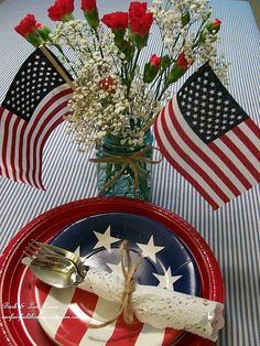 Patriotic Picnic BBQ #USA. Red white and blue stars and stripes place setting with a vase and two mini American flags.