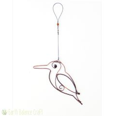 Kingfisher Decoration - A copper wire hanging decoration outlining the beautiful rounded contours of the British kingfisher bird.