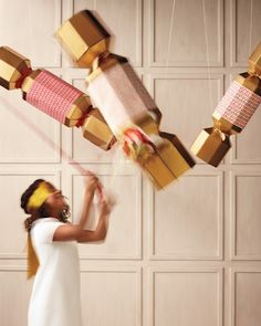 Baby Shower Crafts: Have your guests take turns whacking at a mystery pinata -- the loot will shower down in candies of one color or the other.