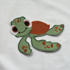 This listing is for an iron on or sew on patch. This is not a finished garment!  Add this cute Squirt Turtle to a T-shirt, shorts, sweats, a jacket, a book bag or a pillowcase! The possibilities are limitless!  This patch comes in 3 sizes Large - 8.17x5.82 Medium - 4.99x6.99 Small - 3.87x2.82  The iron on patches are backed with heat n bond ultra hold and directions are sent for applying. I highly suggest that if you choose iron on and it is applied to something that will be worn and…