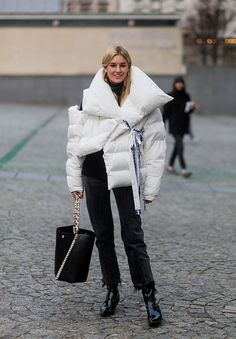 Camille Charriere wearing a white down feather jacket outside Vetements on January 24 2017 in Paris Canada
