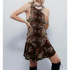 Free people printed slip dress tunic NWT Stunning drop.waist. Ties at back. Light and airy. Perfect to wear alone or layer it up.  Color is eggplant combo Size medium NWT $ 88  All prices are negotioable Bundle and save the most! Free People Dresses