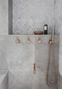 The shower niche has long been the standard of bathing good storage, but what's next? My guess is something simpler and more modern.