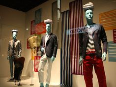 the male model, pinned by Ton van der Veer The men are drssed casually in jackets and pants with tee shirts but the lines behind them in the colors they are wearing really pulls this together i love the shirts folded on top of their heads