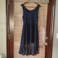 Forever 21 dress Beautiful navy high low tank dress.  Elastic waist and lace overlay on top. Dresses High Low