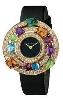 §Limited edition Bvlgari Astrale Watch  set with diamonds and eleven different coloured gemstones. The opulent timepiece is made in 18 carat gold