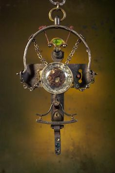 Neckpiece: TWO SIDES OF HISTORY. (2009)  $3,299.00  Steel animal trap, steel wire, drawer-pull, copper, nickel silver, brass, glass, upholstery tacks, pearls, antique steel keys, steel bolt, optometrist test lens, seaweed root-ball fragment, 18th-century French map, vintage earnuts, steel-point engraving (1850's), linen thread, leather, paint, soil.