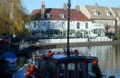 What more attractive sight after a winter walk along the towpath than the traditional British Pub.  The whitewashed walls reflect in the water, and the weeping willow seems to invite us in as it swoops low over the narrow boats moored to the river bank.