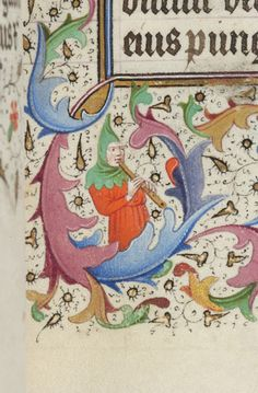Mn wearing hat grasping vine ascending from initial; man wearing hood playing recorder   Book of Hours   France, possibly Lille   ca. 1445   The Morgan Library & Museum