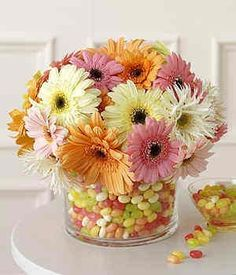 Spring flowers & jelly beans- a smaller vase inside a larger vase arrangement. Jelly beans can still be eaten after blooms fade.