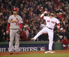 Boston Red Sox's Shane Victorino, right, reacts after driving in three runs with a double in the third inning during Game 6 of the World Ser...