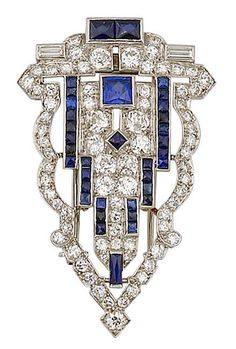 A art deco diamond and synthetic sapphire clip brooch, circa 1925 the openwork shield set throughout with old European-cut diamonds and accentuated with French-cut synthetic sapphires