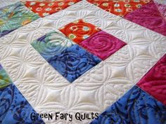 machine quilting -she has lots of heavily quilted freehand designs