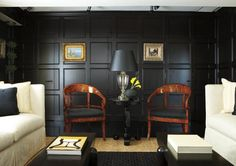 Black paneling is not only beautiful it is practical. The paneling disguises elevator doors and a closet on one wall of this living room. Interior design by Dalia Tamari, photography by Michael Partenio Smooth Operator | New England Home Magazine