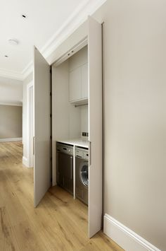 You don't need a dedicated laundry room when a large cupboard with space for a washing machine and tumble dryer works just as well. Maximise storage by slotting in cupboards and a rail for hanging clothes. Pick pocket doors that glide into a cavity in the wall if you don't want doors to infringe on your space.