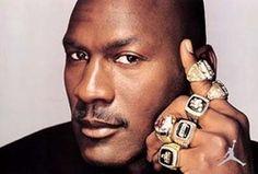 Micheal Jordan with is Six NBA Championship rings