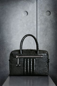 The Rally Bowling Cocco. The classic bowling bag, in crocodile embossed cowskin, detailed with studded pullers.