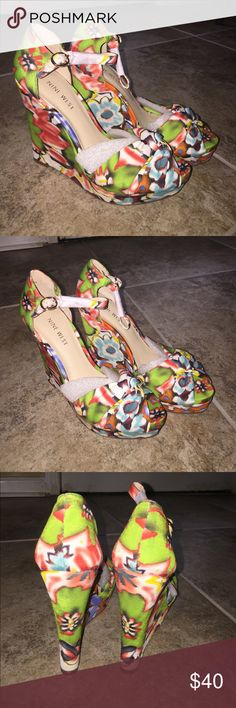 Brand New no Box. Nine West Wedge Heels Size 6M Multi color Floral wedge heels. Size 6M. 5 inches high. Brand new without box. Nine West Shoes Wedges