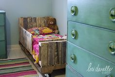 PALLET BED: This is a great idea to make for my 3-year-old who keeps rolling out of bed.
