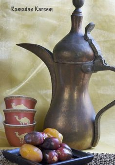 Traditional Arabic Coffee Pot with Arabic Coffee Cups and Fresh Dates