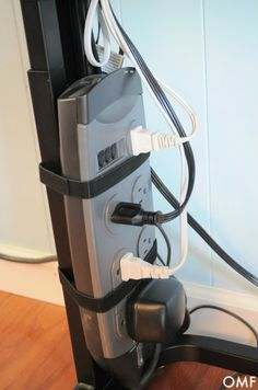 Secure a power strip to the leg of a desk or table with Velcro to keep cords off the floor and tangle-free