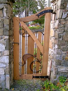 wood and iron - This is so whimsical!  I love this for a hidden garden gate....oooh! Secret Garden!