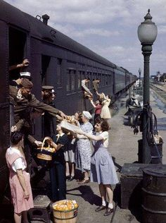 Farm women who gave gifts of food to service men traveling by train, 1945