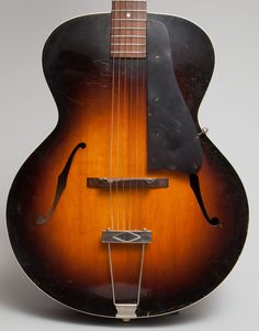 1938 Gibson L-50 archtop guitar in very good condition.  This guitar is all original, finish, frets, nut tuners, etc  www.trcrandall.com