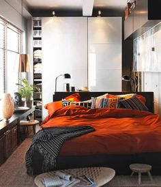 myidealhome: orange bedding (viahunkadoodle) I like the height of the bed and the frame itself.