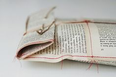 old book pages made into envelopes for favors.