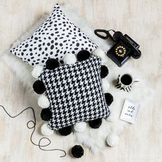 Need a classic look? Our black and white prints are the perfect finishing touch to any look. TIP: We made the pom pom accented pillow from our knitted houndstooth throw!