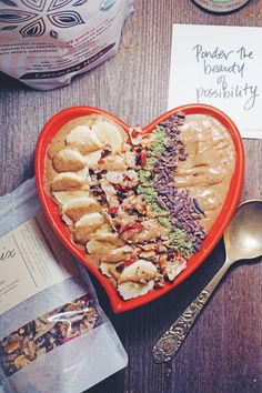 Chocolate Protein Smoothie BowlChocolate Protein Smoothie Bowl served in a heart bowl with Sprout Living protein and gigi's remix granola, plus a truth bomb!
