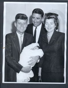 JFK with his sister Patricia and his brother-in-law Peter Lawford with their first born child.