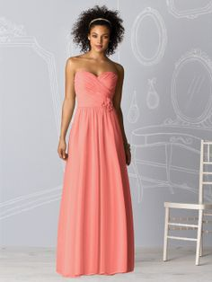 Full length strapless lux chiffon dress w/ shirred bodice and matching flower detail at natural waist. Also available cocktail length as style 6609.