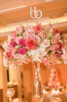 a tall blush, coral, pink wedding centerpiece at the La Valencia Hotel