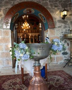 Baptismal font decorated with color flowers