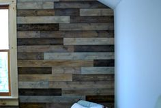 This EXACT project for the wall behind our bed. Light weight snap planks stained and installed. EASY!