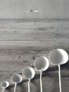 tableware: irregular formed spoons in pure white | cutlery . Besteck . couvert | Design: Caroline Swift |