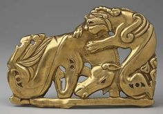 Belt plaque: battle between a monster and a horse, Siberia, 4th-3rd C. BCE Chased gold.