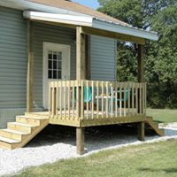 "This is an 8x8 free standing deck with 2 sets of stairs, 5x5 posts and wood railing. The porch is also an 8x8 with a 16"" overhang. The roof is white tin and the trim is also white tin."