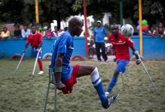 Members of the Haiti Amputee Soccer team play a game marking the International Day of Persons With Disabilities, organized by Partners In Health at the Zanmi Ben Center in Croix des Bouquets, Haiti, on December 3, 2011. Haiti Soccer, Polo Team, International Day, World Of Sports, Photojournalism, Daily Inspiration, Dream Cars, Bouquets, Cool Photos