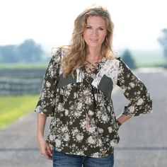 aurora floral top- This mix media Aurora floral top brings together solid green, floral print, and lace accents for the perfect combination