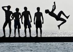 Boys jump in the water on the first sunny day of spring in Malmo, Sweden, April 2, 2011. Temperature in Malmo reached 17 degrees Celsius (63 degrees Fahrenheit), signaling the end of an unusually long and hard winter. (Reuters/Johan Nilsson)