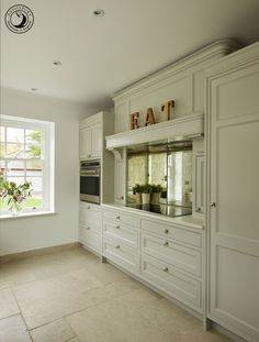 The classically styled mantel is modernised by the antique mirror splashback.