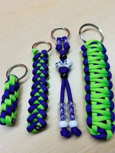 4 matching paracord keychain bundle purple and neon green.