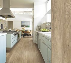Shaw laminate in a white oak visual inspired by mellow oil-rubbed floors. Style Canterbury, color Thyme.