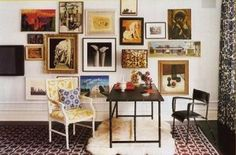photo frames decor on wall-can't put that many holes in the wall but gives me ideas....