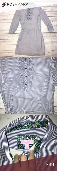 Lilly Pulitzer Pinstriped Shirt Dress 0 Pinstriped Shirt Dress by Lilly Pulitzer in size 0. Has beautiful ruffled collar with buttons, sash, and detailed cuffs with buttons. Gently worn with no rips, tears, or stains. Easily dressed up or down. Perfect for spring and summer. Lilly Pulitzer Dresses