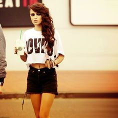 Cher Lloyd, perfect hair and outfits .  Sportswear but still smart, GREAT (: