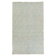 Jute rug with a concentric diamonds motif. Hand-woven in India.    Product: RugConstruction Material: Jute